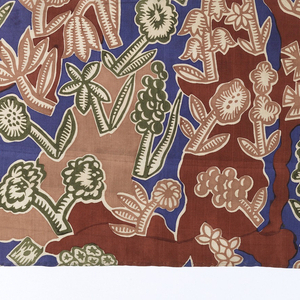 Shrubs and flowering plants as in a rocky garden on white silk. 4 colors or blocks: 2 browns, green, blue. Possibly a 5th color: the light brown flowers. Length less than height of repeat unit.