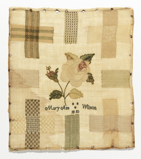 Darning sampler with four crosses, and four swatches with rose in the center.