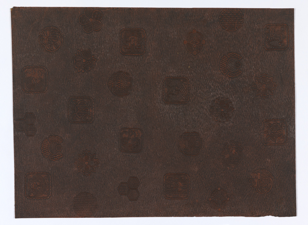 Vertical rectangle. About 20 medallions composed of geometrical designs, foliate and flower forms, and fantastic birds, beasts and fish. Arranged at random against horizontal wave background. The latter is reddish-brown over which black has been washed.