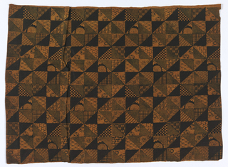 Repeating design made up of adjoining small triangles, some filled in with solid color, the others ornamented with small geometrical figures and flower designs. Dark brown and gray on yellowish ground.