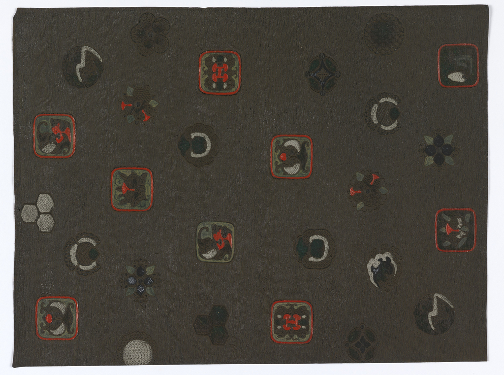 Vertical rectangle. Approximately twenty emblems of different shapes arranged at random. Several of the motifs occur twice with either coloring or direction changed. Geometrical, foliate and mask designs are included. Horizontal wave background. The later is greenish-brown over which black has been washed.