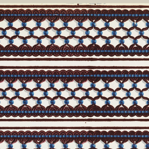 Passementerie or imitation fancy gimp border. Threads, in two shades of deep red, are gathered together at regular intervals with blue beads. Narrow bands of blue stitching near top and bottom edges. Printed in red flock and blue on white satin ground.   H#92