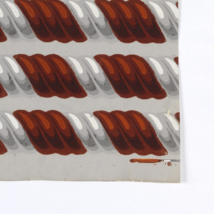 Rope twist or cable molding design. Design consists of three twists of rust-colored flock with two twists of gray. The rust-color flock is overprinted with two colors. Printed in rust flock, orange, dark orange, shades of gray and white on a light gray ground. Printed five across.  H# 531A
