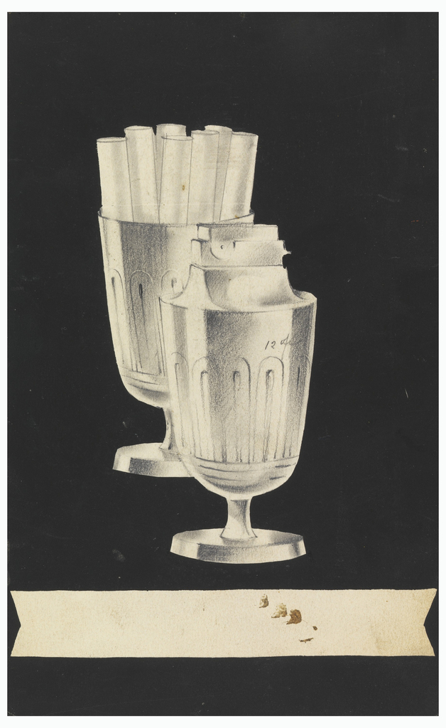 Goblet-shaped lighter and matching cigarette holder with attached round bases. The lighter is shown in front and is slightly obscuring the holder.  Decorative ring with long and narrow, double loops decorate the sides just below cup's widest point; flaring stems and raised bases beneath each cup; straight horizontal banderole at lower-center is blank and has chevron-shaped cut-outs at either end.