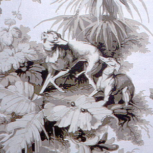 A reproduction of a French wallpaper printed by Zuber in style of 1840-50. Two alternating vignettes. One is composed of three putti at play. One is riding a dog, one is on a swing. Luxuriant foliage surrounds them. The other scene is of two hounds among palms and other tropical foliage. Printed in shades of sepia on cream-colored ground.