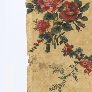 Bouquets of red roses and carnations, with floral swags. Printed on yellow ground with red pin dots.  H# 395