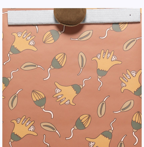 Fanciful, organic shapes, printed in orange and green, on a rust-colored ground. The large floral-motif has a hand-like appearance.