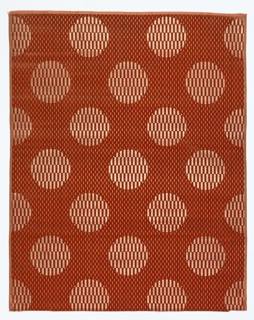 Orange cloth ground with silver. Background has all-over design of minute voided vertical rectangles. Large-scale staggered horizontal repeat of circular medallion filled with small vertical rectangles alternately velvet and ground fabric.