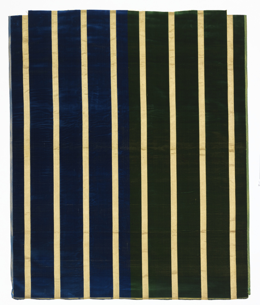 Broad vertical stripes of solid cut velvet alternating with narrow gold satin stripes. Sample shows two colorways: left half has blue stripes and the right has green.