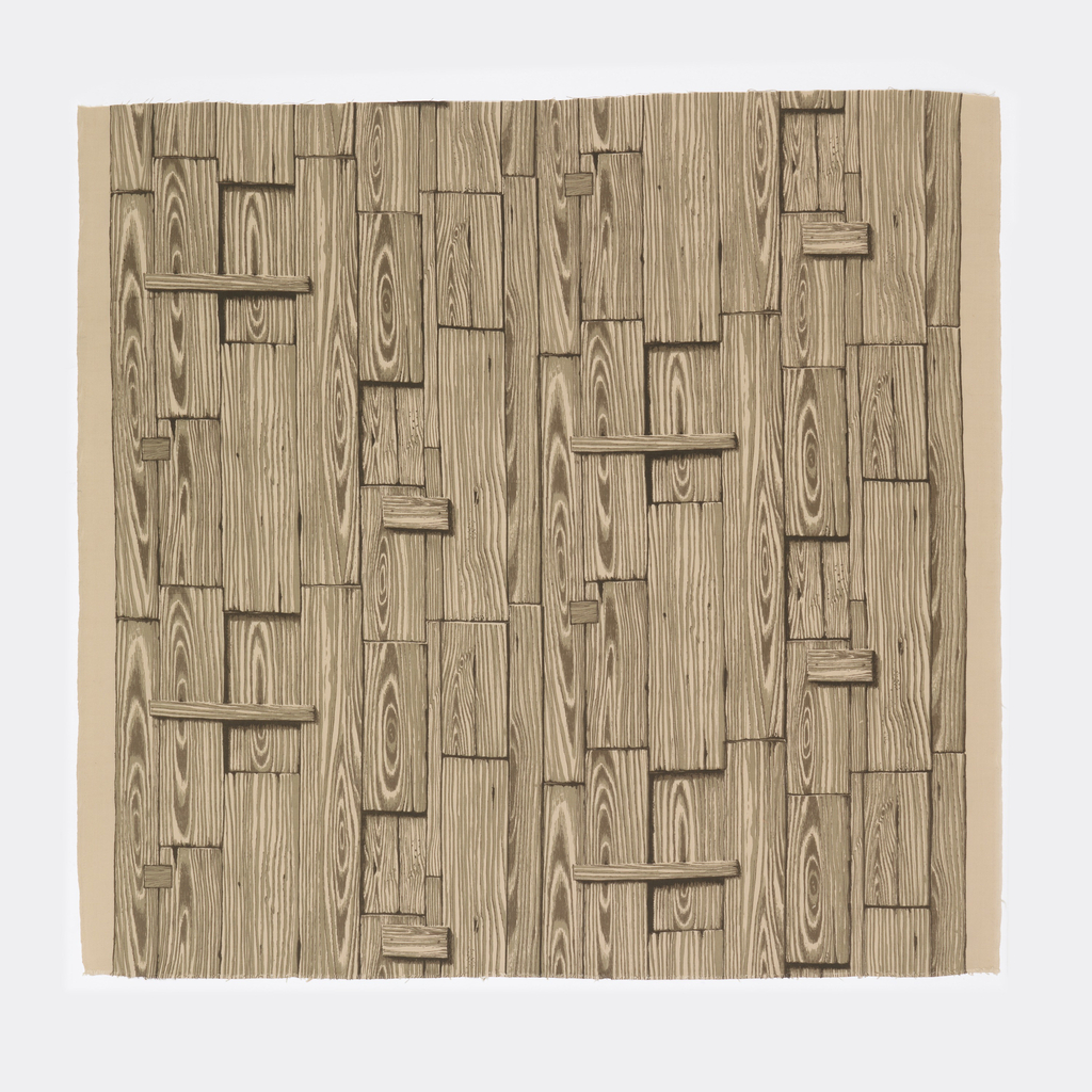 Length of printed cotton with a design imitating strongly grained wood, pieced and patched as for a fence, in shades of taupe and brown on a tan ground.