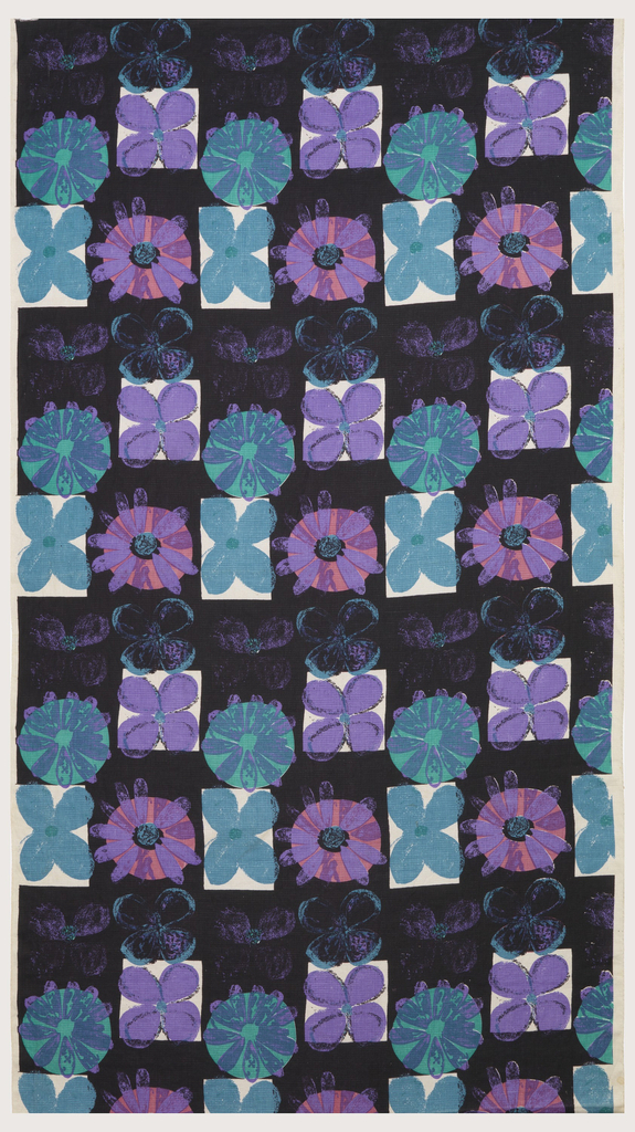 Length of printed linen with a black and white checkerboard, each square with a simply-drawn daisy-type flower in turquoise, purple or pink.