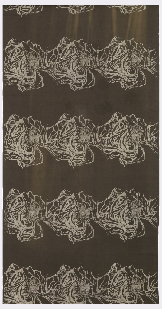 Length of printed cotton with bands of contiguous organic shapes which resemble tree knots, root systems, or shells, in fine white line on a dark grey ground.