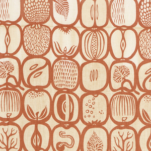 Length of printed cotton with a grid of stylized apples, some with worms, printed in rusty-red on natural color ground.