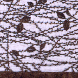A backdrop of tangled willow is paired with leaves which create an airy delicacy achieved by thrust carving. Silk threads have been added to support the overall structure of the stencil. The numbers 250 are written in red on the lower left corner. There is slight staining along the right side of the stencil.