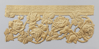 Embossed entablature in beige decorated with wavy lines containing quatrefoils, beneath which are curled thorny branches bearing roses and leaves.