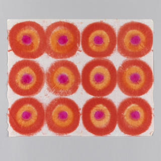 Twelve concentric circles in red, orange and pink in rows.