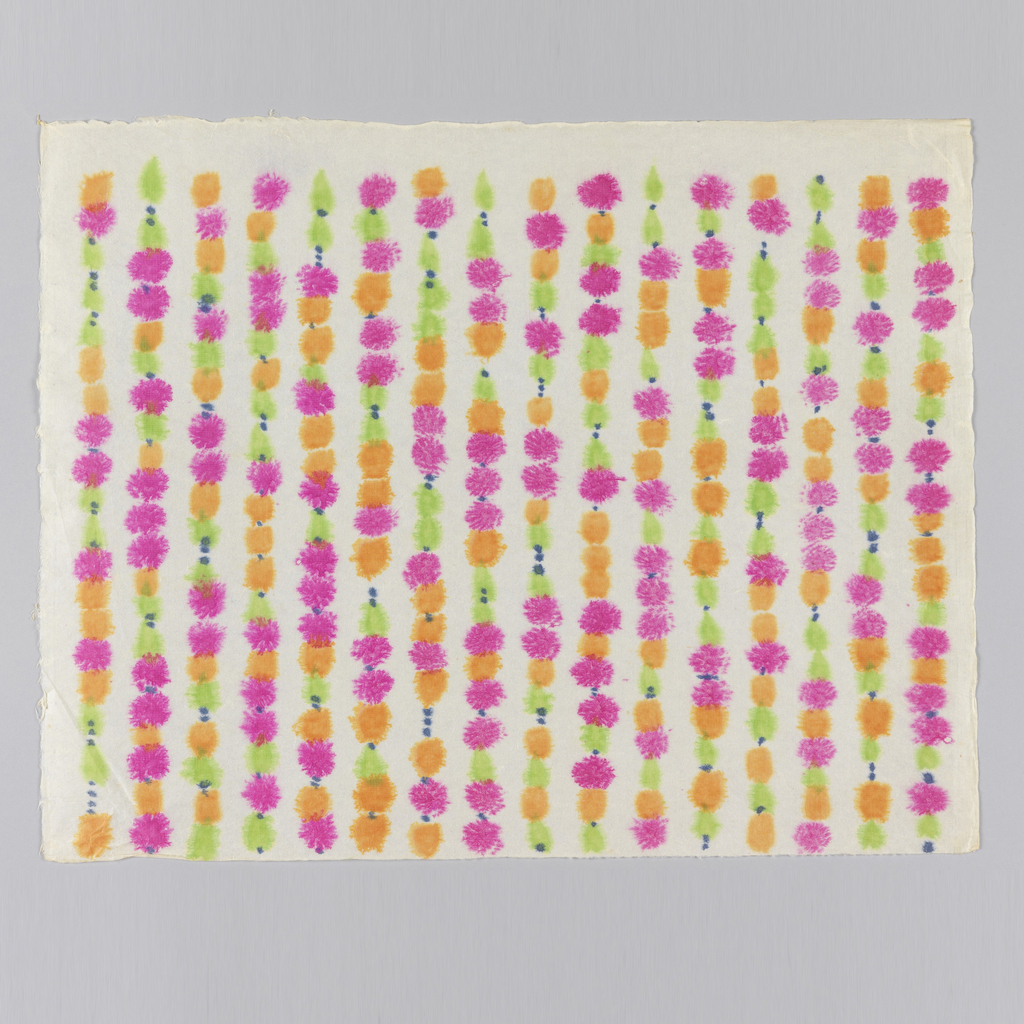 Pattern of strung beads in shades of pink, orange and green with small blue spacer beads. On white paper.