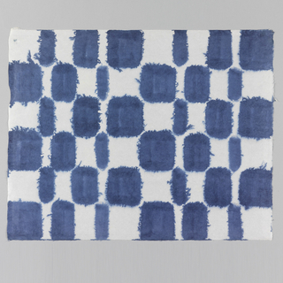 Tile design in blue on white paper.
