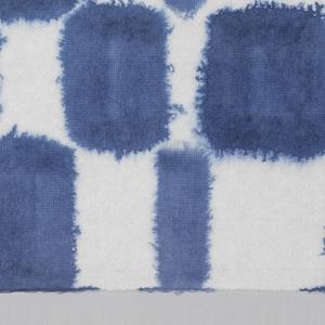 Tile design in blue on white paper.