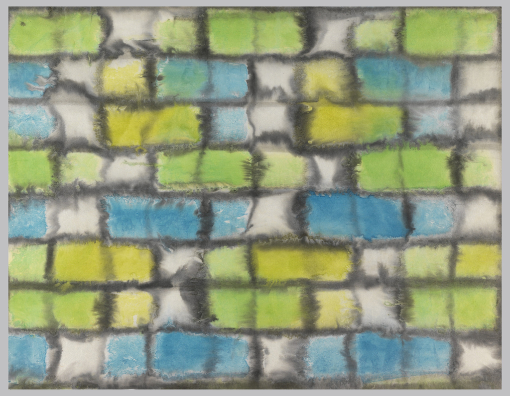Blue, yellow and green tile design on white paper.