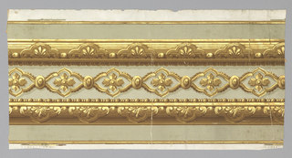 Central band of linked quatrafoils with inset floral boss. Band of architectural molding with bead and reel above and below. Printed in brown, tan, metallic gold and gray on white ground.