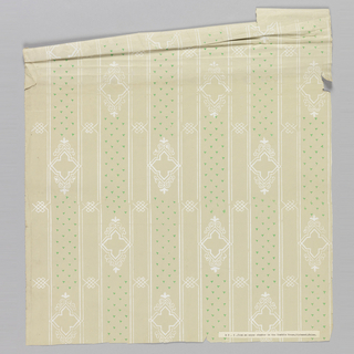 Stripe design, with diamond quatrefoils alternating with clusters of green triangles. Printed in white and green on a taupe satin or polished ground.