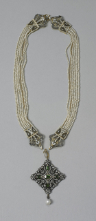 Gold and enamel necklace composed of three components: two sections of six-strands of seed pearls flanking a pendant with five peridots, diamonds, and drop pearl. Components can be separated to form two bracelets and stand-alone pendant.
