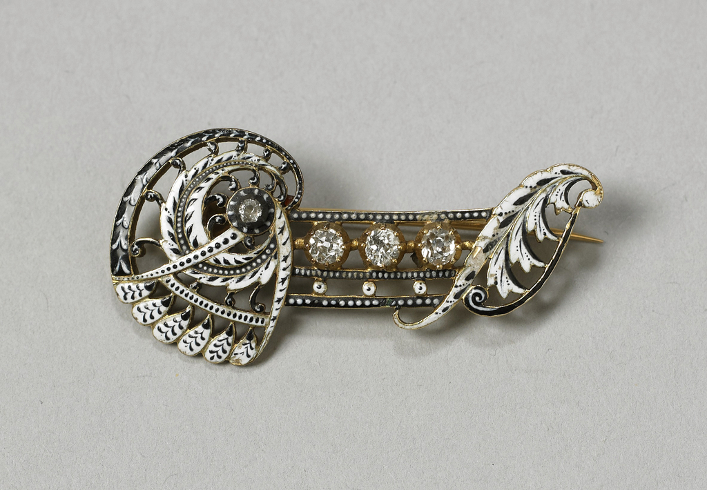 Gold and enamel brooch with four Old Mine diamonds.