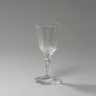 Faceted cup on stem on octagonally faceted foot.