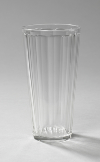 Tapered faceted cylindrical form with gilt line near rim.