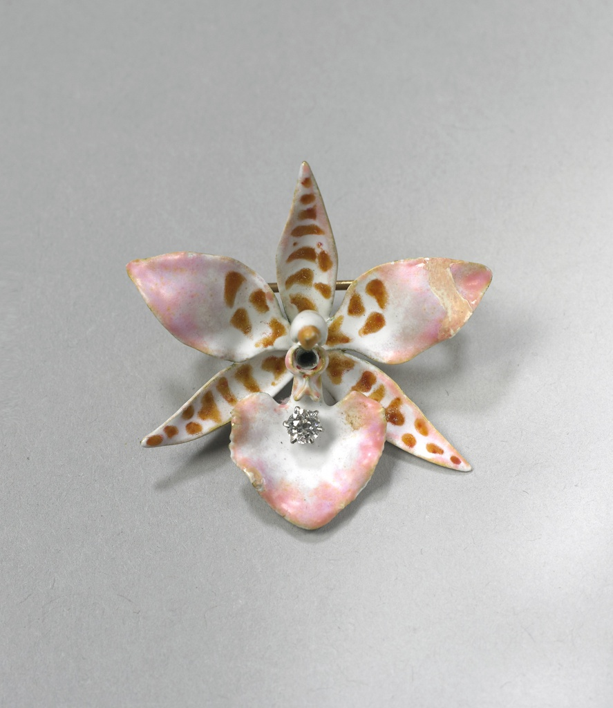 """Enameled gold brooch in the shape of an six-petal orchid with diamons in the center of """"flower."""""""