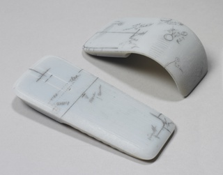 Up-curved, tapering rectangular form in white resin, the surface annotated with designers' marks and comments in pencil.