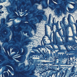 """Two Catalonian landscape scenes in blue on white surrounded by densely flowering branches. The first scene, """"Vista del Puente del Diablo en Martorell,"""" shows a medieval bridge with a pointed arch. There is a path to the bridge where a man reclines by a stone wall and a strolling couple moves toward the Roman arch that stands before bridge. The second scene, """"Vista del Monasterio de Montserrat,"""" shows the monastery with the serrated mountains in the background. The Virgin of Montserrat is seated in the foreground on a bed of clouds and is attended by two angels."""