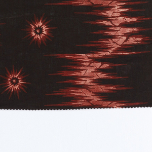Printed cotton with jagged serpentines in red and red-stippled white on black ground, scattered with small jagged rosettes in same colors.
