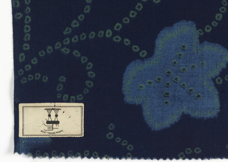 Cotton printed in imitation of tie-dye. Design of leaves and dotted tendrils in yellow-green and soft blue on dark blue ground.