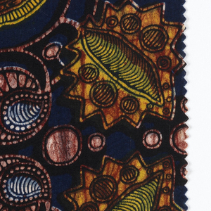Printed cotton with scrolling vine and fantastical fruits and pods. Irregular colors of yellow, orange and pink with crackle effect, with background of deep blue. Pattern is in resist or discharge with colors overprinted. One plain undyed selvedge with blue crackle. Warranted indigo blue according to the label.