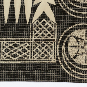 """Printed cotton with a large-scale repeating design composed of interlace motifs, stars inside of spirals, and the """"eight swords"""" motif. The design is in imitation of the embroidery on riga or robes worn by Hausa men in Nigeria. Printed in white on a small-scale windowpane check of white on a dark blue ground."""