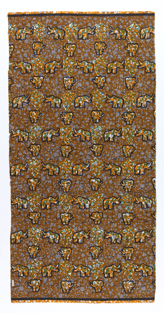 Cotton printed in a crudely-executed imitation of batik.  A grid of elephants, in profile and frontal view, with coconut trees. Overall small-scale diamond pattern in the ground.  In dark blue, green, yellow-orange, and white.