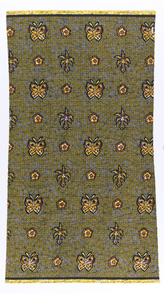 Cotton printed in imitation of batik with detached motifs of butterflies, palm trees and rosettes against a small-scale, overall pattern of diamond shapes. In dark blue, red and yellow.
