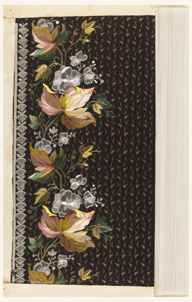Dark brown ground with a light brown vermicular pattern embroidered in a border design of naturalistic flowers in shades of rose, green, yellow and white.