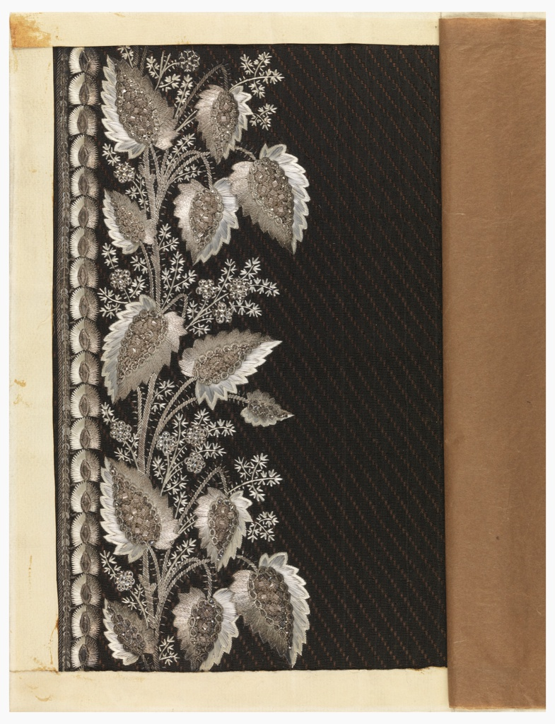 Floral design embroidered in white silk, silver thread and wire, and silver sequins on a brown ground.