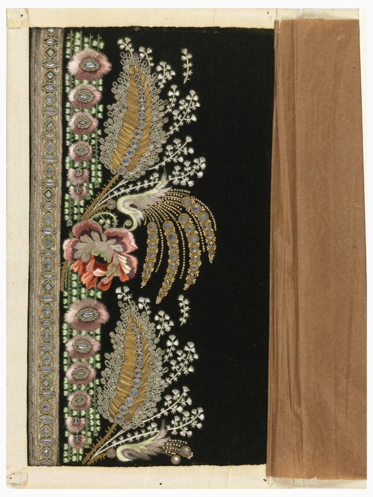 Floral design embroidered with multicolored silk, silver and gold threads and wire coils, stamped gold appliqué and mirrored glass beads on a solid green velvet ground.