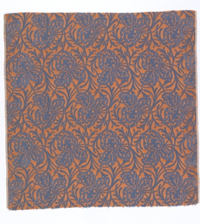 Ground fabric of fancy cloth weave, minute orange chevron design. Large-scale allover design of iris blossoms and scrolling foliage in two depths of blue velvet uncut pile.