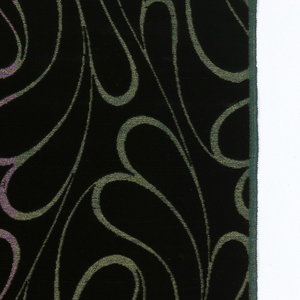 Black velvet ground with an allover design of deeply looping lines in metallic gold. Four different colors of metallics – blue, orange, violet and green – in the ground.