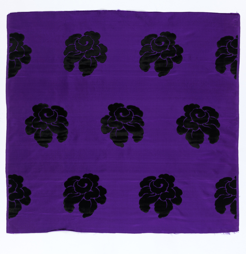 Staggered horizontal repeat of large scale stylized roses. Roses are in black on a purple satin ground.