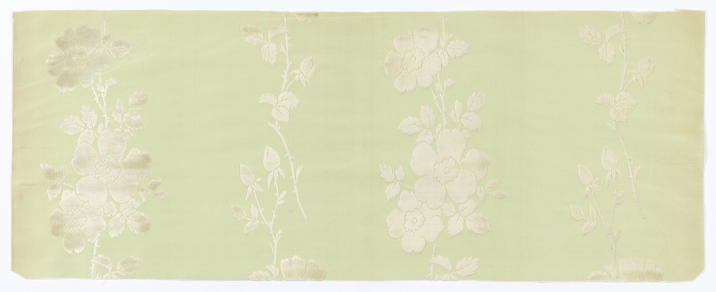 Vertical bands of wild roses in white velvet on a ribbed pale green ground.