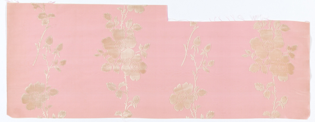 Vertical bands of wild roses in white velvet on a ribbed pink ground.