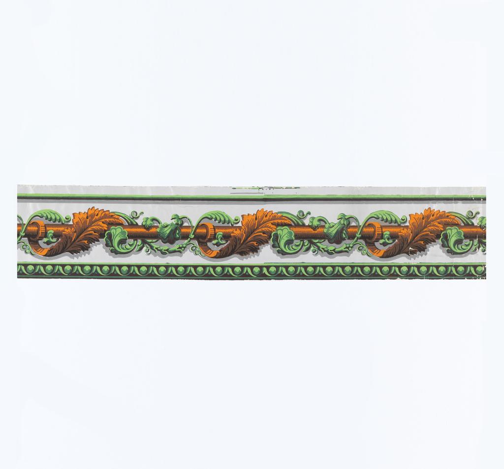 Orange and green acanthus leaves twist around a horizontal orange rod. Printed on gray glazed ground.