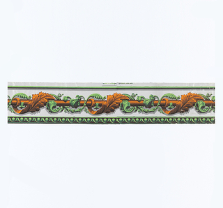 Orange and green acanthus leaves twist around a horizontal orange rod. Printed on gray glazed ground.