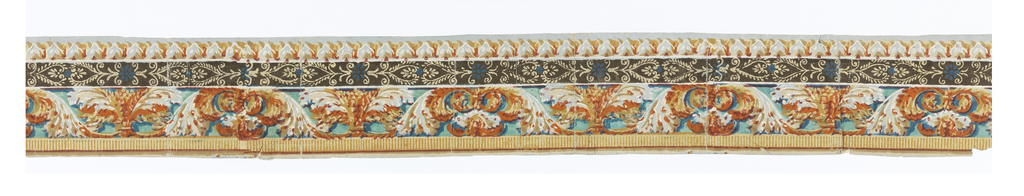 """This piece is probably one band of a border design originally printed in five or six bands, for the width of the wallcovering. Each band consists of four strips of varied patterns: the top strip forms a continuous dentilled """"fringe""""; the center strip is the widest, containing an acanthus rinceau design. The bottom strip is a combination of what appears to be fleur-de-lis edged in a scalloped line; printed in blues, yellow, ochre, orange, tan, magenta, ecru, white and burnt sienna.  H#614"""